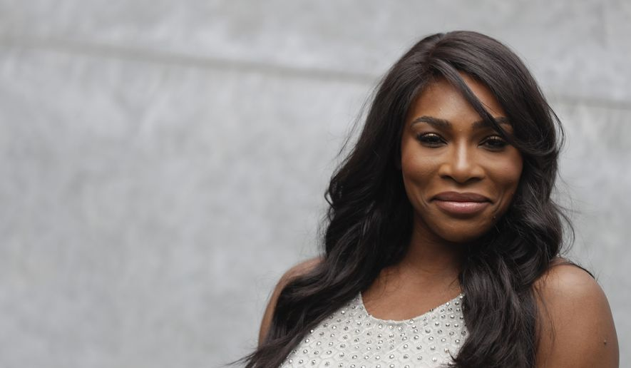 """FILE - In this Sept. 23, 2016, file photo, U.S. tennis star Serena Williams poses for photographers prior to the start of the Giorgio Armani women's Spring-Summer 2017 fashion show, that was presented in Milan, Italy. Williams penned an open letter for Porter Magazine that was republished by the Guardian newspaper on Nov. 29, 2016. In it, she calls on women to """"continue to dream big."""" (AP Photo/Luca Bruno, File)"""