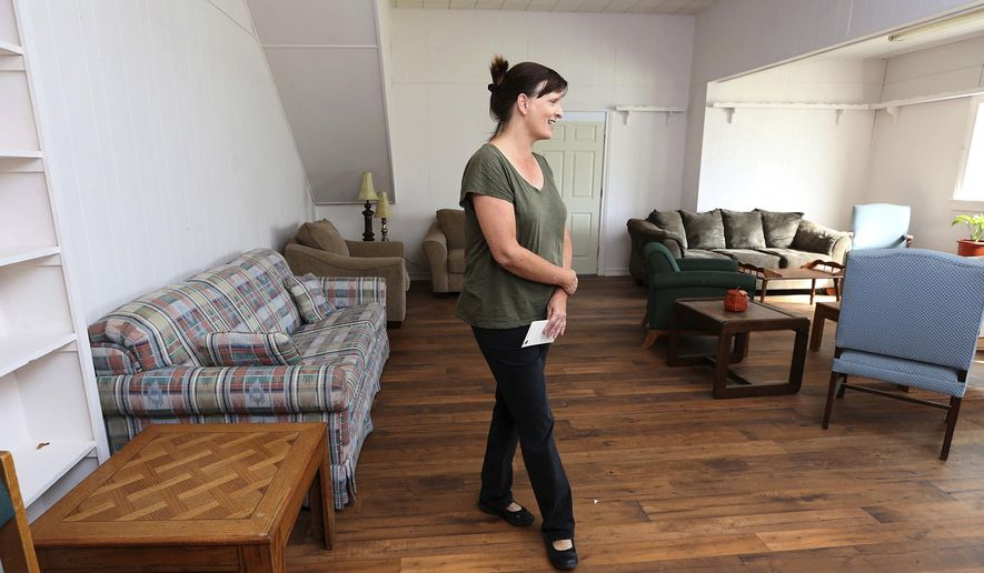 Luann Jennings walks through the newly opened Good Neighbor House Tuesday, Nov. 15, 2016, in Waco, Texas.  The house has been renovated and opened as a neighborhood social hub aimed at breaking down prejudices, separation and fear.   (Rod Aydelotte/Waco Tribune-Herald via AP)