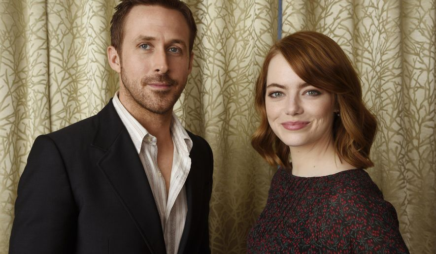 "This Sept. 12, 2016 photo shows Ryan Gosling, left, and Emma Stone posing for a portrait to promote their film, ""La La Land,"" at the Shangri-La Hotel in Toronto. (Photo by Chris Pizzello/Invision/AP)"