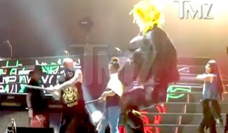 Guns N' Roses fans beat a Donald Trump pinata during a show in Mexico City on Wednesday Nov. 29, 2016. (TMZ screenshot)