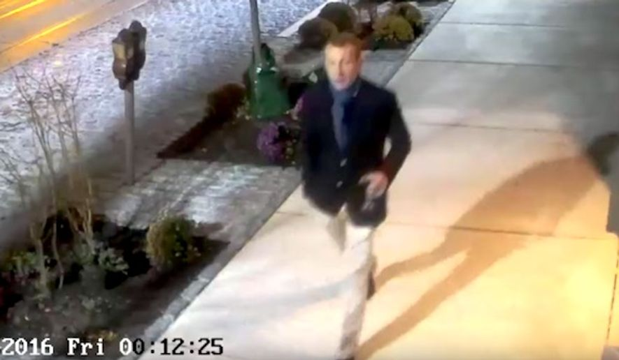The Philadelphia Police Department released video footage on Tuesday Nov. 29, 2016, of two men connected with vandalizing a Fresh Market grocery store with anti-Trump graffiti. City officials say Duncan Lloyd, an assistant city solicitor caught on surveillance cameras during the crime, has contacted police. (YouTube, Philadelphia Police Department.)