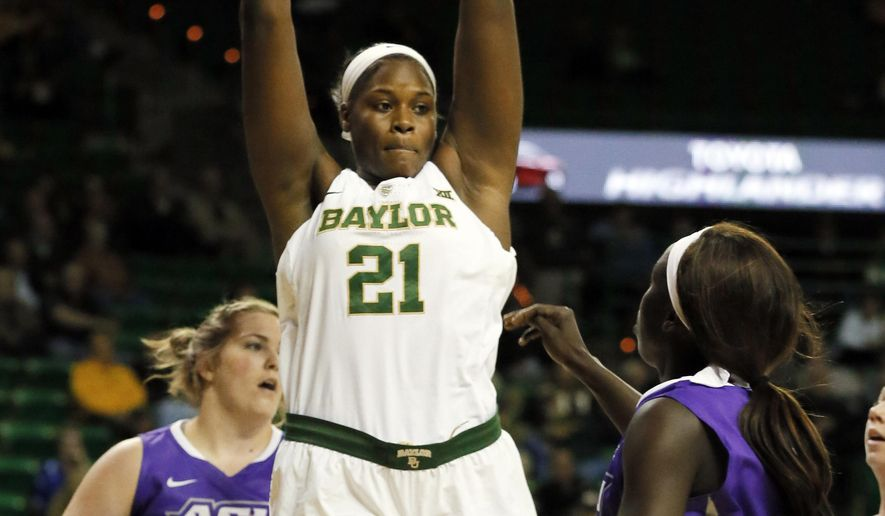 Baylor center Kalani Brown (21) grabs a rebound over Abilene Christian forward Sydney Shelstead, rear, and Suzzy Dimba, right, in the first half of an NCAA college basketball game, Thursday, Dec. 1, 2016, in Waco, Texas. (AP Photo/Tony Gutierrez)