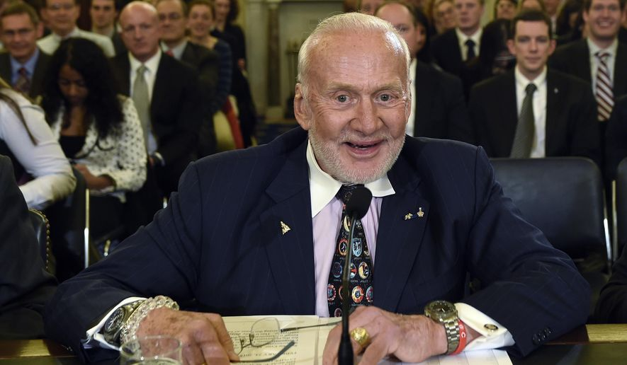 FILE - In this Tuesday, Feb. 24, 2015, file photo, Buzz Aldrin, former NASA Astronaut and Apollo 11 Pilot, prepares to testify on Capitol Hill in Washington, before the Senate subcommittee on Space, Science, and Competitiveness hearing on human exploration goals and commercial space competitiveness. Officials said Aldrin, one of the first men to walk on the moon, has been evacuated by plane from the South Pole for medical reasons. An association of Antarctica tour operators said Thursday, Dec. 1, 2016, that Aldrin was visiting the South Pole as part of a private tourist group when his health deteriorated. (AP Photo/Susan Walsh, File)