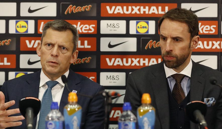 Martin Glenn, left, Chief Executive of the English Football Association gestures as he speaks to the media along side Gareth Southgate the newly confirmed England soccer team manager during a press conference in the headquarters of the English FA, at Wembley stadium London, Thursday, Dec. 1, 2016. (AP Photo/Frank Augstein)
