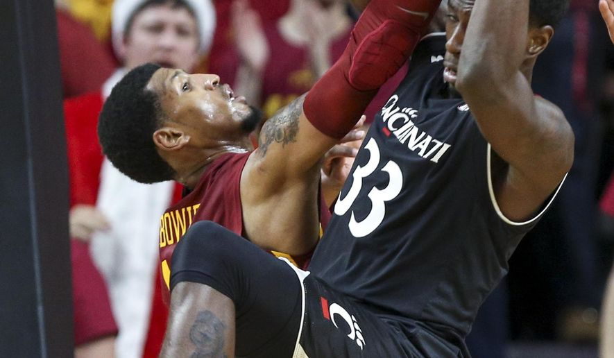 Cincinnati center Nysier Brooks, right, hauls in a rebound over Iowa State forward Darrell Bowie during the first half of an NCAA college basketball game, Thursday, Dec. 1, 2016, in Ames, Iowa. (AP Photo/Justin Hayworth)