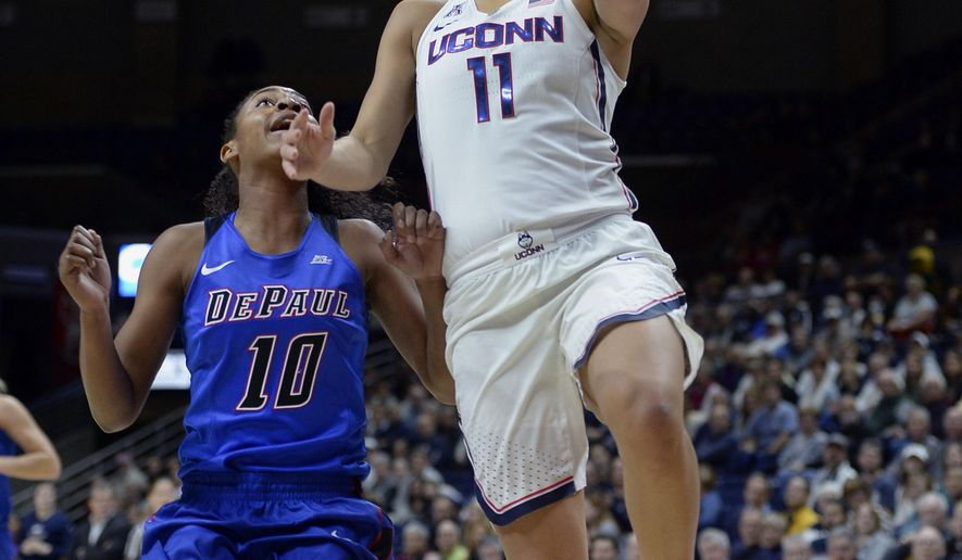 Connecticut's Kia Nurse goes up for a basket as DePaul's Amarah Coleman, left, defends in the first half of an NCAA college basketball game, Thursday, Dec. 1, 2016, in Storrs, Conn. (AP Photo/Jessica Hill)