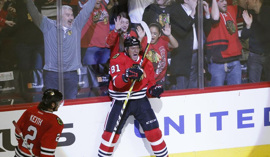 Chicago Blackhawks' Marian Hossa (81) celebrate his game winning goal as Duncan Keith (2) watches during the overtime period of an NHL hockey game against the New Jersey Devils, Thursday, Dec. 1, 2016, in Chicago. The Blackhawks won 4-3. (AP Photo/Charles Rex Arbogast)