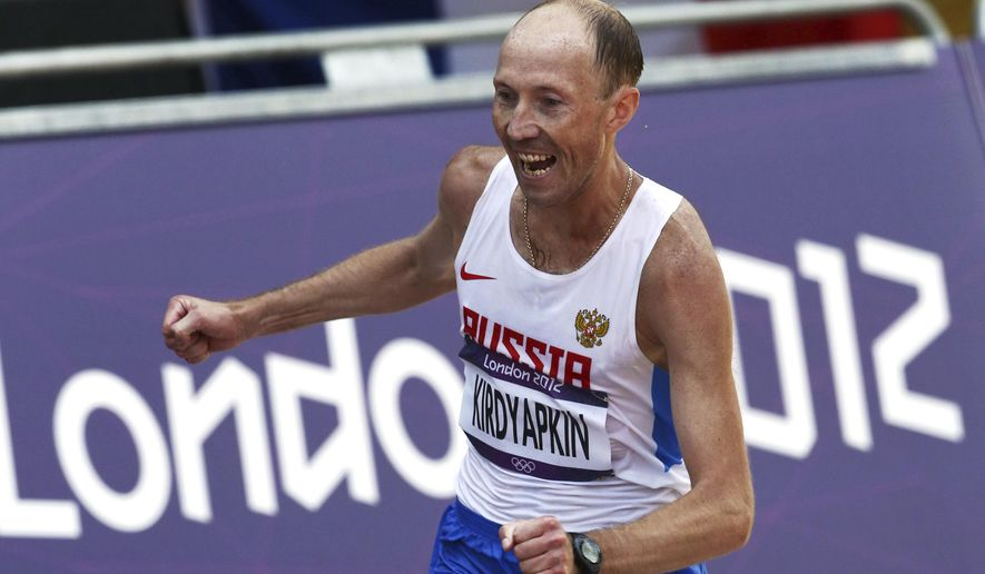 FILE - In this Saturday, Aug. 11, 2012 file photo, Sergey Kirdyapkin, of Russia, wins the gold medal in the men's 50-kilometer race walk at the 2012 Summer Olympics, in London. Russian walker, Sergei Kirdyapkin, is obliged to pay back a total of at least $90,000 for numerous wins at major competitions after he was banned in 2015. (AP Photo/Sergei Grits, File)