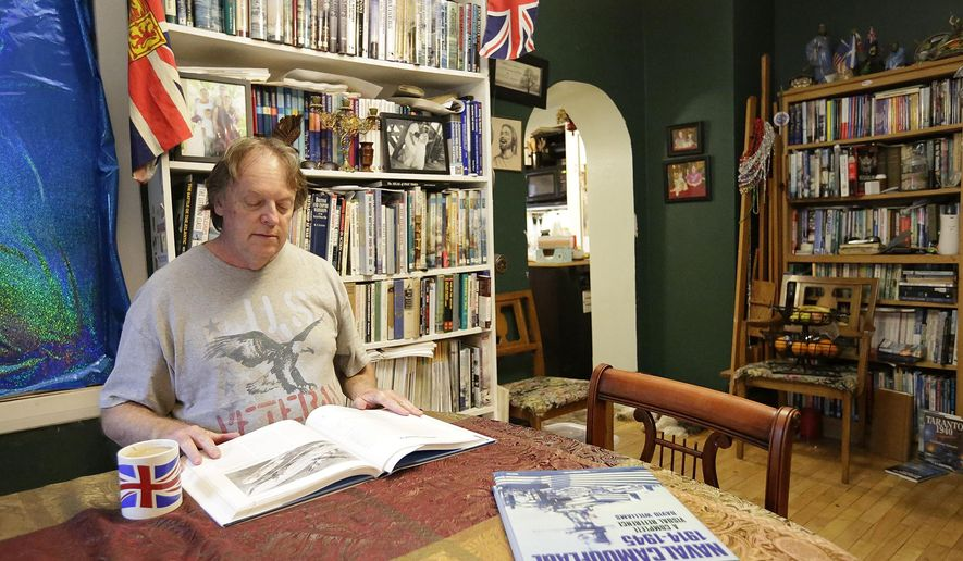 In a Friday Nov. 25, 2016 photo, Steve Hayward reads a book in his Fond du Lac, Wisc., home. (Doug Raflik/The Reporter via AP)