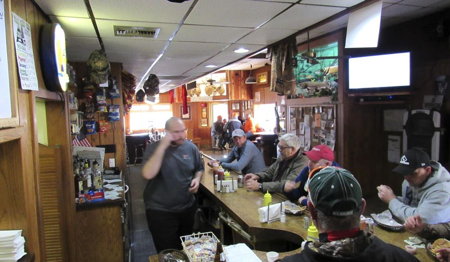 In this Nov. 21, 2016 photo, patrons sit at the counter at the I-Diehl Tap in Plain, Wis. Fewer deer hunters have stoppy by  since the introduction last year of electronic registration. (Barry Adams/Wisconsin State Journal via AP)