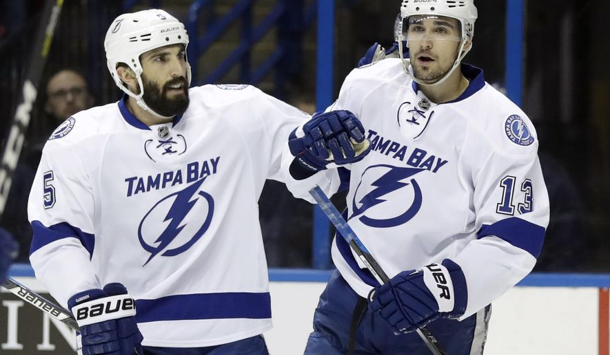 Tampa Bay Lightning's Cedric Paquette (13) is congratulated by Jason Garrison after scoring during the first period of an NHL hockey game against the St. Louis Blues on Thursday, Dec. 1, 2016, in St. Louis. (AP Photo/Jeff Roberson)