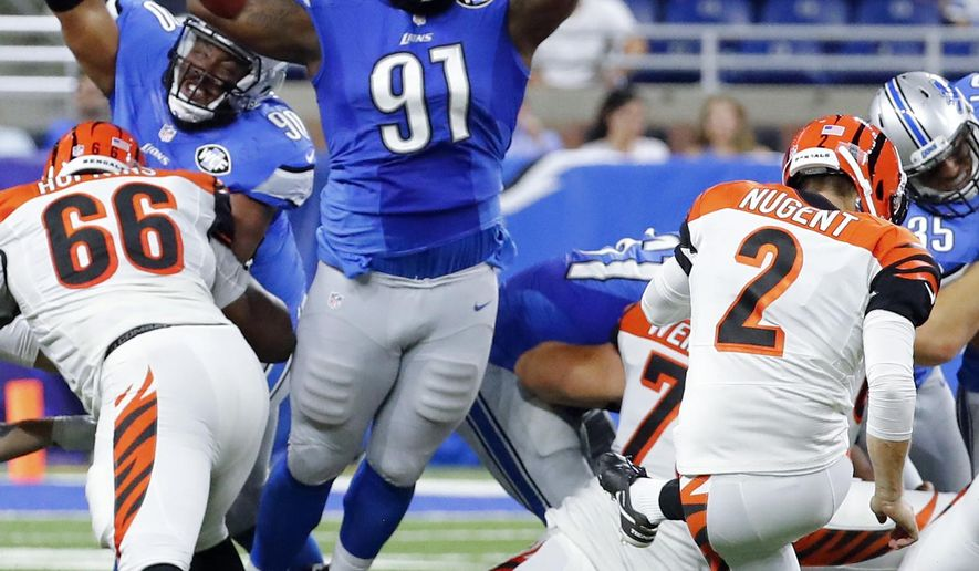 FILE - In this Aug. 18, 2016, file photo, Detroit Lions defensive tackle A'Shawn Robinson (91) jumps to try and block a Cincinnati Bengals kicker Mike Nugent (2) field goal in the second half of an NFL preseason football game in Detroit. Robinson is emerging as a key player for the NFC North leaders. The former Alabama standout has a knack for knocking down passes, a skill the Texan says comes from his background as a basketball player in high school.  (AP Photo/Rick Osentoski, File)