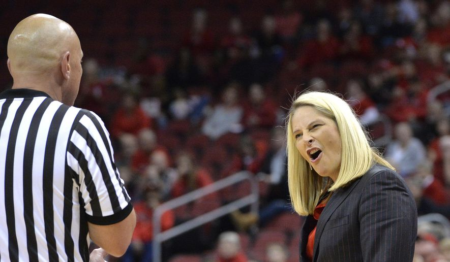 Maryland's head coach Brenda Frese argues a call with a game official during the first half of an NCAA college basketball game against Louisville, Thursday, Dec. 1, 2016, in Louisville, Ky. (AP Photo/Timothy D. Easley)