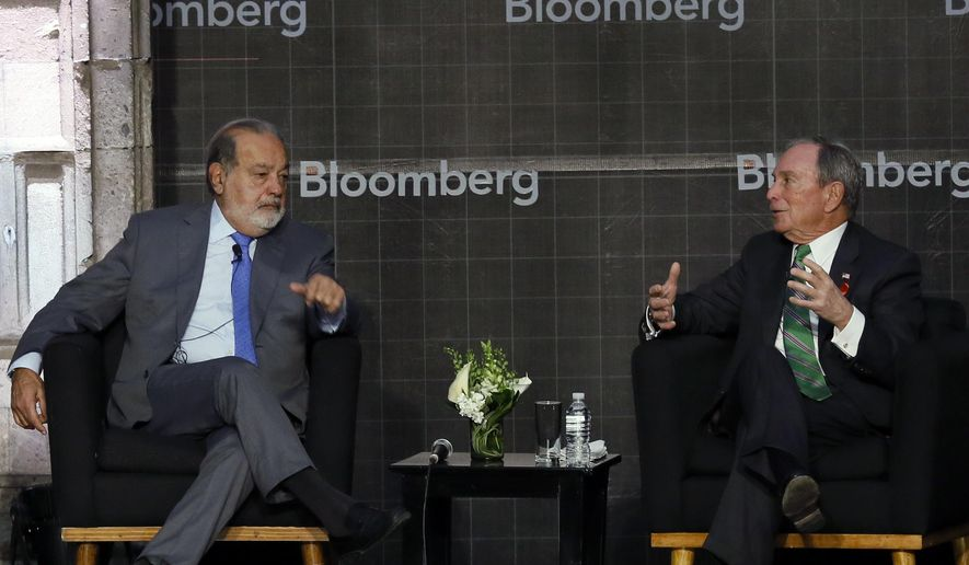 Mexican billionaire Carlos Slim and former New York City Mayor Michael Bloomberg take part in an event discussing Mexico's relationship to the U.S., in Mexico City, Thursday, Dec. 1, 2016. Bloomberg and the mayors of dozens of the world's largest cities were gathering this week at the C40 Mayors Summit in Mexico City to discuss concrete steps to achieve the carbon emission-reducing goals set by world leaders in Paris. (AP Photo/Marco Ugarte)