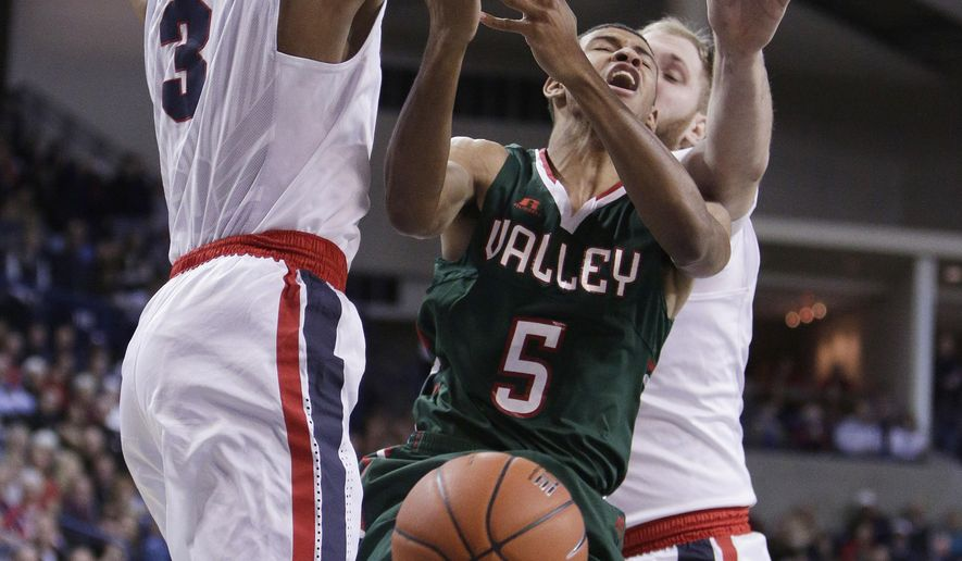 Gonzaga forward Johnathan Williams (3) blocks a shot by Mississippi Valley State guard Rashaan Surles (5) during the first half of an NCAA college basketball game in Spokane, Wash., Thursday, Dec. 1, 2016. (AP Photo/Young Kwak)