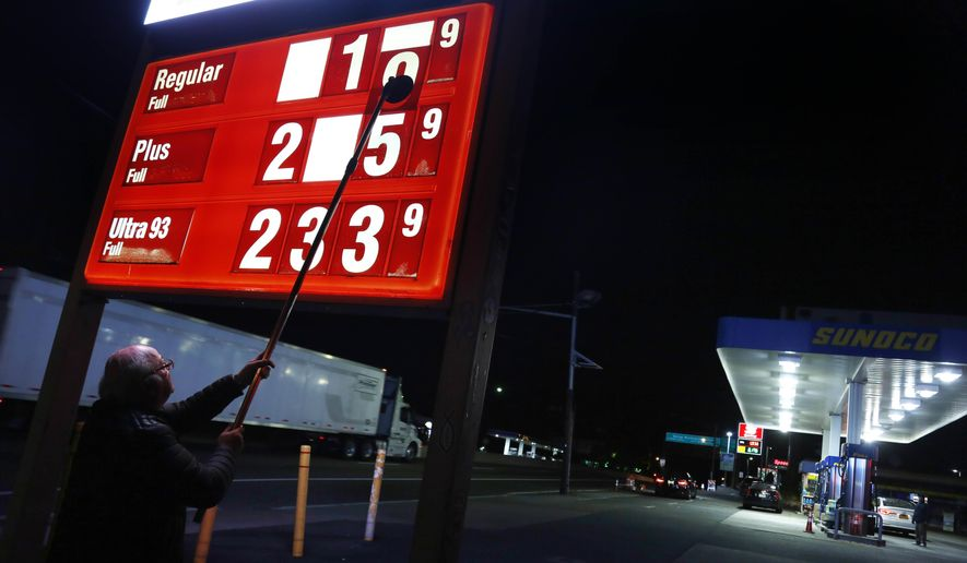 In this Tuesday, Nov. 1, 2016, file photo, Leon Balagula changes the price for the gasoline at his Sunoco station in the early morning, in Fort Lee, N.J. (AP Photo/Seth Wenig, File)