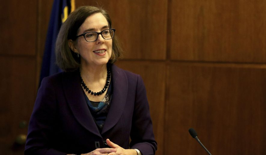 Oregon's Gov. Kate Brown speaks about her proposed 2017-2019 budget at the Oregon State Capitol in Salem, Ore., on Thursday, Dec. 1, 2016. (Anna Reed /Statesman-Journal via AP)