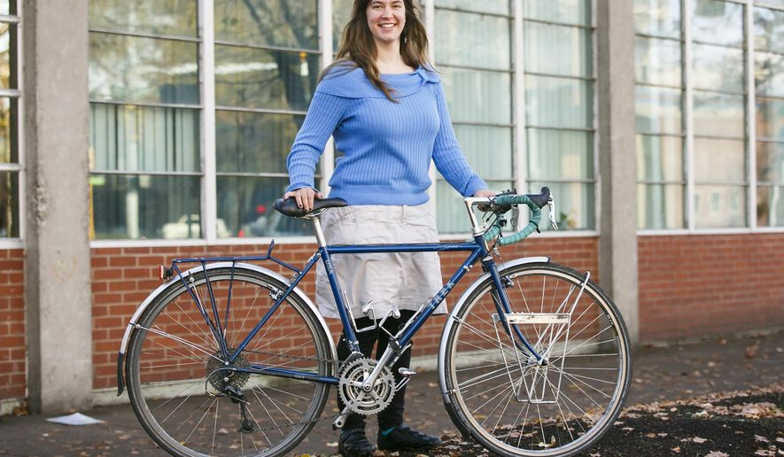 ADVANCE FOR USE SATURDAY, DEC. 3 - In this Nov. 17, 2016 photo, Emily Loberg, 24, who traveled four months solo cross-country by bicycle, poses in from Salem, Ore. Her months-long adventure would take her over the Cascades, near two oceans, across the Great Plains, up the Continental Divide and through 15 states. (Molly J. Smith/Statesman-Journal via AP)