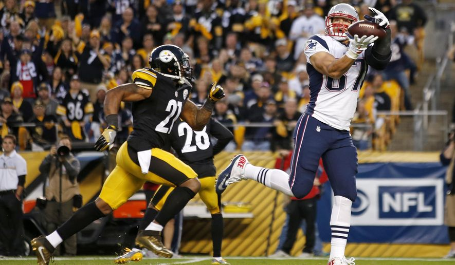 FILE - In this Oct. 23, 2016, file photo, New England Patriots tight end Rob Gronkowski (87) takes a pass from quarterback Tom Brady behind Pittsburgh Steelers strong safety Robert Golden (21) for a touchdown during the second half of an NFL football game in Pittsburgh. Gronkowski is having surgery for a herniated disk in his back, a person with knowledge of the details tells The Associated Press. The person spoke Thursday, Dec. 1, 2016, on condition of anonymity because the surgery has not yet been announced by the team. The surgery was first reported by the Buffalo News. (AP Photo/Jared Wickerham, File)