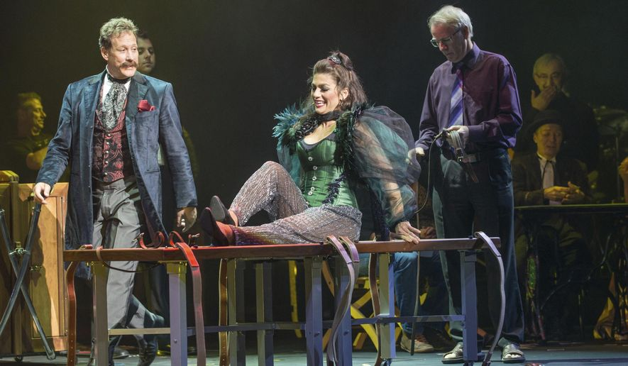 "This image released by DKC shows Jinger Leigh, center, performing with her husband Mark Kalin, right. Leigh, who is known for elaborate illusions like levitating and sawing someone in half, is part of, ""The Illusionists _ Turn of the Century,"" at the Palace Theatre in New York. (The Illusionists/DKC via AP)"