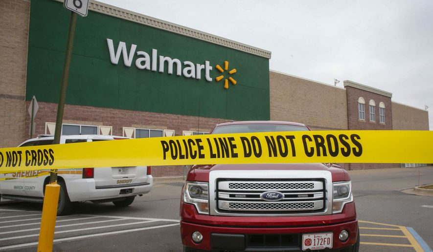 Police tape cordons off a portion of a Wal-Mart store after a pickup truck crashed through the front entrance of the grocery portion of the store, killing multiple people, Thursday, Dec. 1, 2016, in Pella, Iowa. (Bryon Houlgrave/The Des Moines Register via AP  )