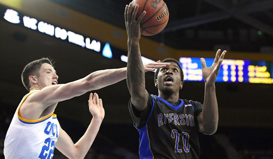UC Riverside forward Secean Johnson, right, shoots as UCLA forward TJ Leaf defends during the first half of an NCAA college basketball game, Wednesday, Nov. 30, 2016, in Los Angeles. (AP Photo/Mark J. Terrill)