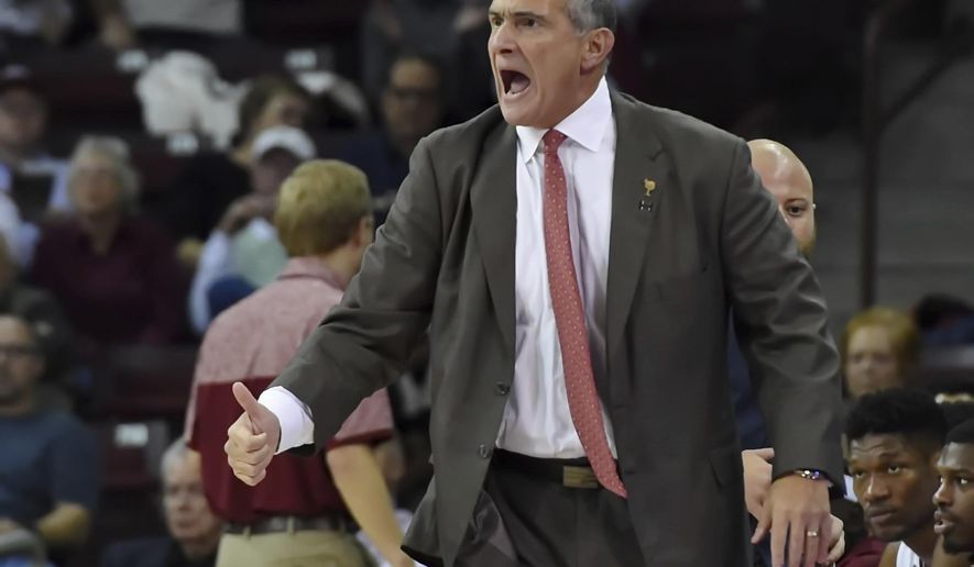 South Carolina's head coach Frank Martin reacts after a play during the first half of an NCAA college basketball game against Vermont on Thursday, Dec. 1, 2016, in Columbia, S.C. (AP Photo/Richard Shiro)