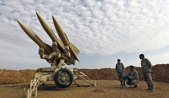 In this photo obtained from the Iranian Mehr News Agency, Iranian army members prepare missiles to be launched during a maneuver at an undisclosed location in Iran on Nov. 13, 2012. (AP Photo/Mehr News Agency, Majid Asgaripour) **FILE**