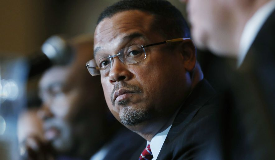 U.S. Rep. Keith Ellison, center, D-Minn., listens with Jamie Harrison, back, chair of the South Carolina Democratic Party, as Ray Buckley, chair of the party in New Hampshire, speaks during a forum on the future of the Democratic Party, featuring candidates running to be the next chair of the Democratic National committee on Friday, Dec. 2, 2016, in Denver. The candidates spoke during the Association of State Democratic Chairs session. (AP Photo/David Zalubowski)
