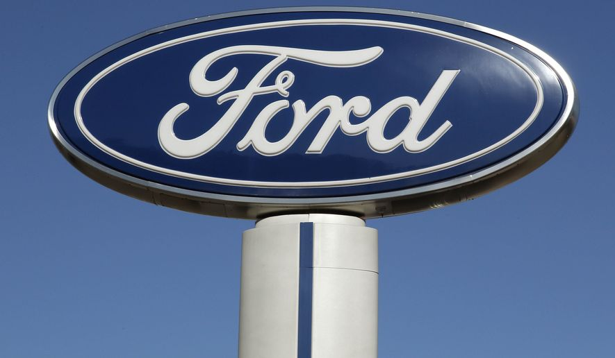This Tuesday, Oct. 25, 2011, file photo shows a Ford sign at the Salem Ford dealership in Salem, N.H. (AP Photo/Charles Krupa, File)