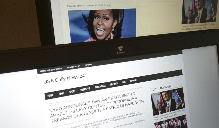 This photograph taken in Paris on Friday, Dec. 2, 2016, shows stories from USA Daily News 24, a fake news site registered in Veles, Macedonia. (AP Photo/Raphael Satter)