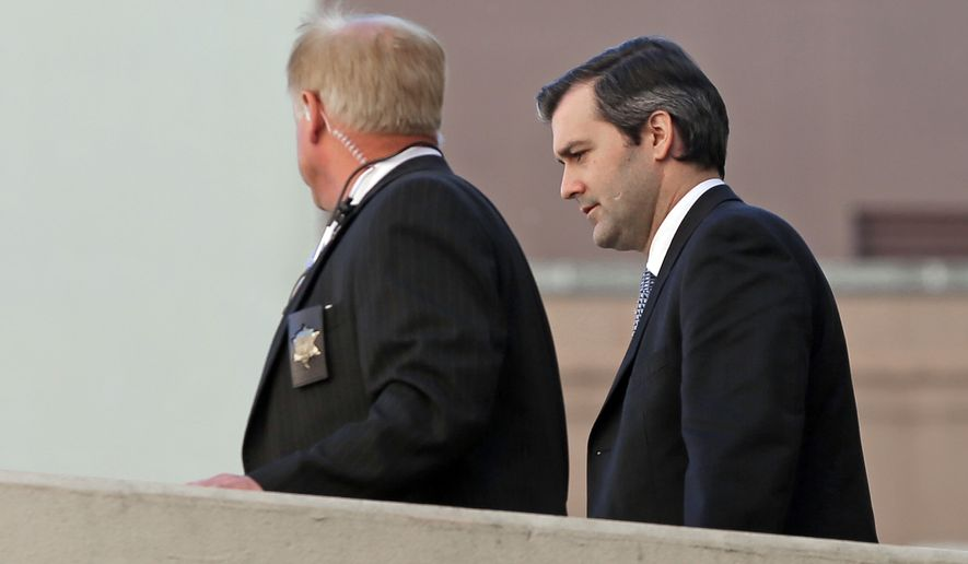 Former North Charleston police officer Michael Slager, right, is escorted from the courthouse during his murder trial at the Charleston County court in Charleston, S.C., Friday, Dec. 2, 2016. The case of the former South Carolina police officer charged with murder in the shooting death of an unarmed black motorist is now before the jury. (AP Photo/Chuck Burton)