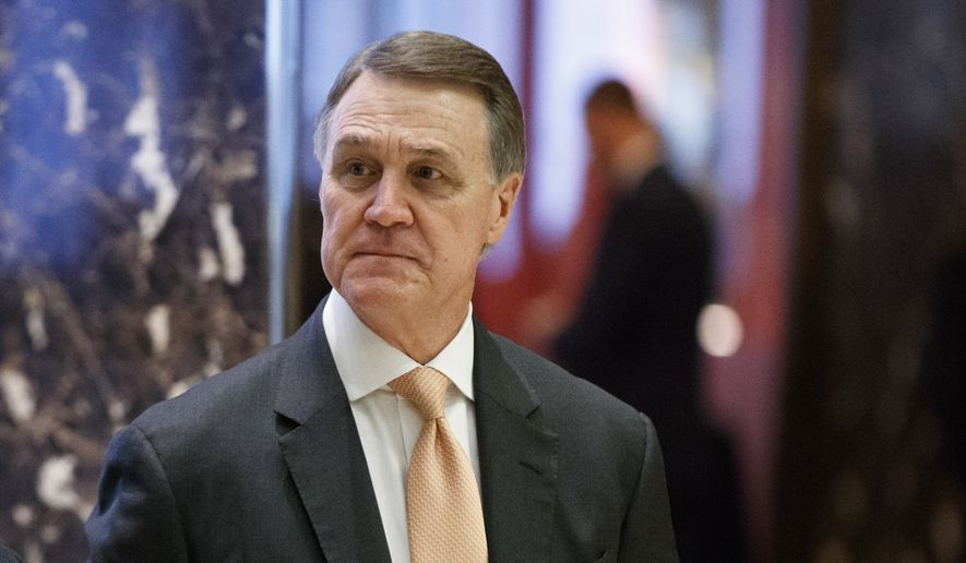 Sen. David Perdue, R-Ga., walks to the elevator for a meeting with President-elect Donald Trump at Trump Tower, Friday, Dec. 2, 2016, in New York. (AP Photo/Evan Vucci) ** FILE **