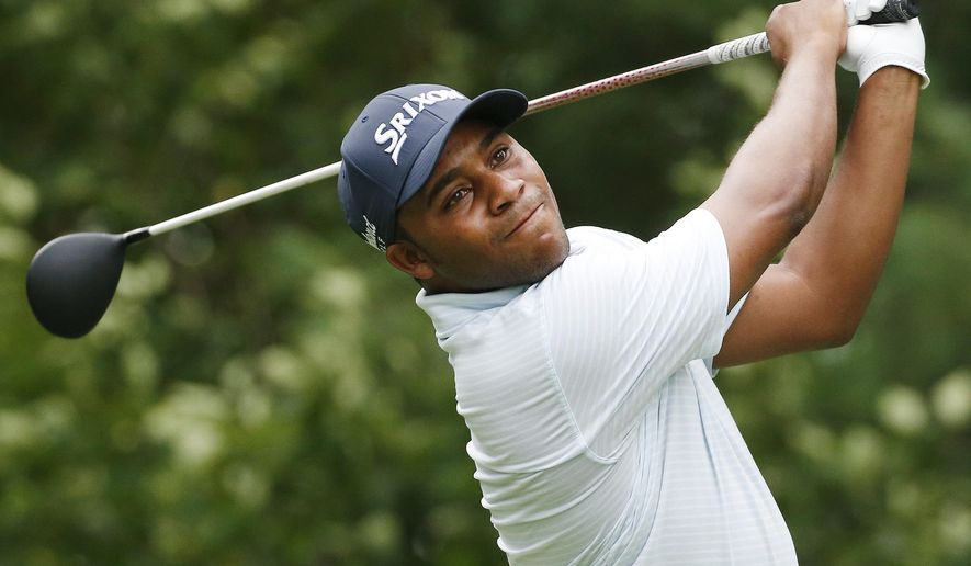FILE - In this Sept. 5, 2016 file photo, Harold Varner III tees off on the ninth hole during the final round of the Deutsche Bank Championship golf tournament in Norton, Mass.. Half the field at the Australian PGA Championship had to set their alarms extra early for a 5:30 a.m. start so they could finish their first rounds and complete their second rounds on Friday, Dec. 2, 2016. (AP Photo/Michael Dwyer, File)