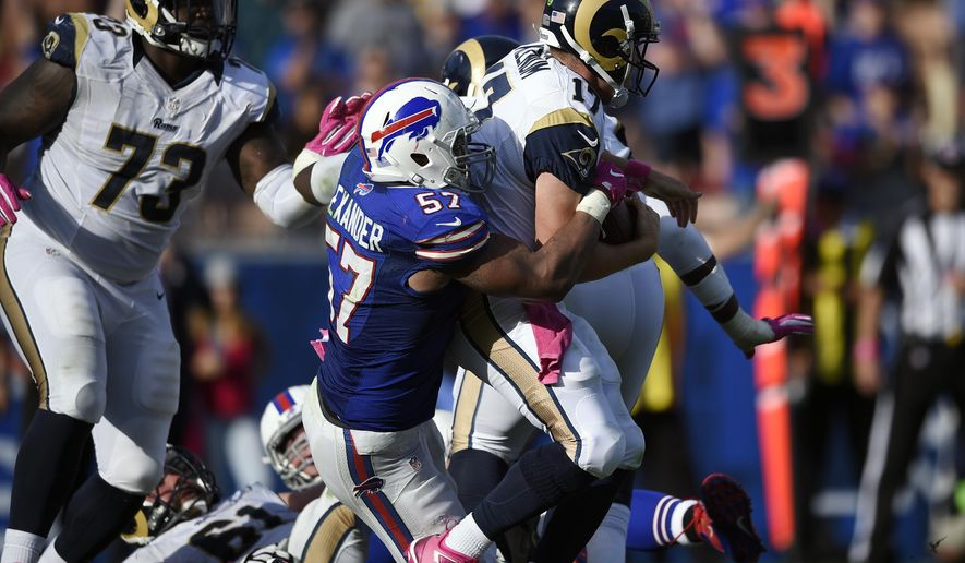 FILE - In this Oct. 9, 2016, file photo, Buffalo Bills linebacker Lorenzo Alexander, left, sacks Los Angeles Rams quarterback Case Keenum (17) during the second half of an NFL football game, in Los Angeles. Alexander will get a up-close look at the resurgent Raiders on Sunday when the Bills visit Oakland. While the Raiders success comes as little surprise to Alexander, the production Alexander has provided the Bills has been a bit of a surprise. (AP Photo/Kelvin Kuo, File)