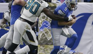 FILE - In this Nov. 20, 2016, file photo, Jacksonville Jaguars defensive tackle Malik Jackson (90) gets past Detroit Lions offensive guard Graham Glasgow (60) to tackle Lions quarterback Matthew Stafford (9) during the first half of an NFL football game, in Detroit. The Jaguars have signed a free agent from Denver in each of the last three seasons, and only defensive tackle Malik Jackson has panned out. The Denver Broncos take on the Jacksonville Jaguars on Sunday in Jacksonville. (AP Photo/Duane Burleson, File)