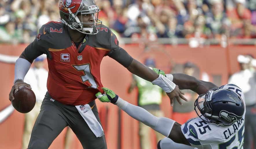 In this Sunday, Nov. 27, 2016, photo, Tampa Bay Buccaneers quarterback Jameis Winston (3) pushes off Seattle Seahawks defensive end Frank Clark (55) during the first quarter of an NFL football game in Tampa, Fla. The Buccaneers (6-5) have won three straight, including last week's 14-5 triumph against Seattle, and are sitting just outside the NFC's second wild-card spot. (AP Photo/Chris O'Meara)