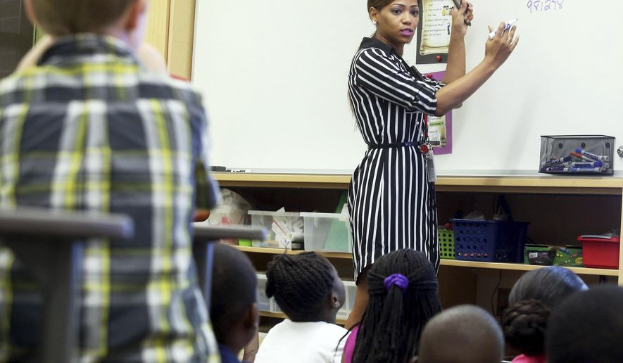 In this Aug. 30, 2016 photo, Springfield Elementary School third grade teacher Graylon Nell uses the Mentoring Mathematic Minds program to teach her students math in Charleston, S.C. (Brad Nettles/The Post And Courier via AP)