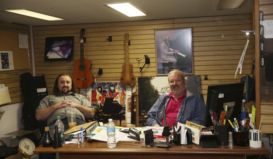 In a Nov. 22, 2016 photo, Steve Gross, left, piano manager for 10 years with Yamaha, is helping Jerry Ridenhour, son of Jim and grandson of Elmer Ridenhour, who started Ridenhour Music 74 years ago, sell the inventory and close the store. After more than 70 years, Ridenhour Music will cease operation in December.  (Stephanie Klein-Davis/The Roanoke Times via AP)