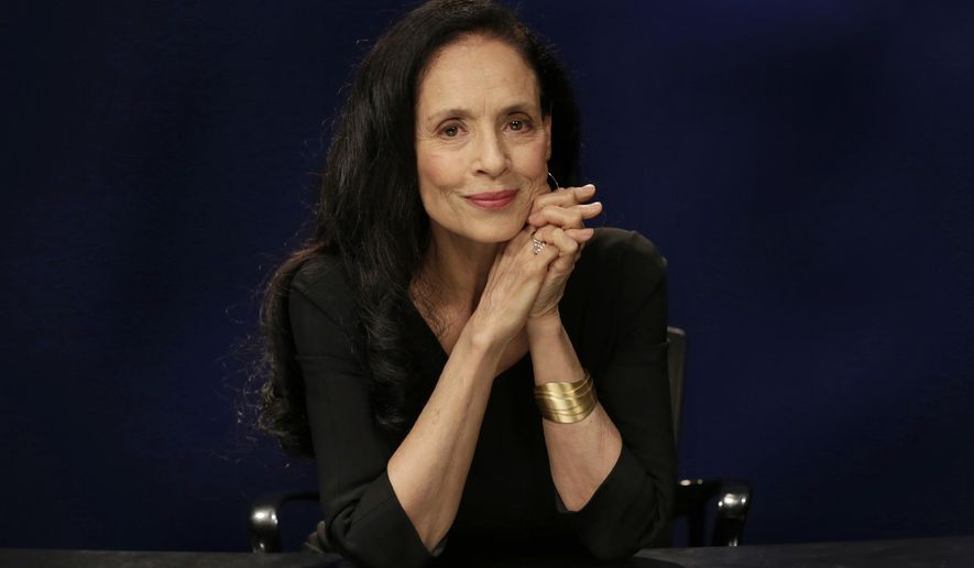 """This Nov. 11, 2016 photo shows Brazilian actress Sonia Braga during an interview about her new film, """"Aquarius,"""" in New York. Braga plays a widow and retired music critic reluctant to sell the seaside apartment that holds her most cherished memories. (AP Photo/Richard Drew)"""