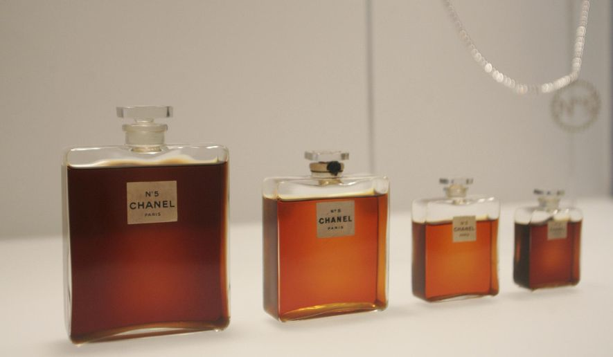 FILE - In this May 2, 2005 file photo, bottles of Chanel No. 5 perfume are displayed at the Metropolitan Museum of Art's Costume Institute exhibit in New York. Chanel is making a stink over a possible high-speed train line through jasmine fields in Provence, warning it could threaten production of its Chanel No. 5 perfume. (AP Photo/Hiroko Masuike, File)