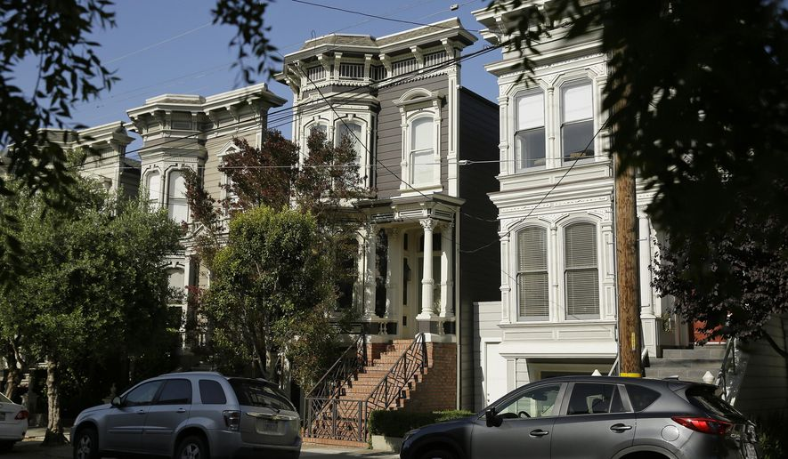 "FILE - This May 27, 2016, file photo, shows a Victorian home, center, in San Francisco, made famous by the television show ""Full House."" The home was sold to producer Jeff Franklin, who created the show. The veteran TV producer bought the 3-bedroom Victorian, which was on the market for over $4 million, in August. The realtor had declined to say at the time who bought the home, which is in San Francisco's Lower Pacific Heights neighborhood. The home's exterior was used as the Tanner family's residence in the original show. (AP Photo/Eric Risberg,File)"