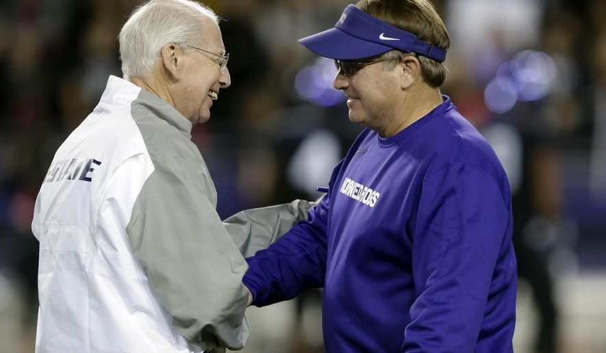 FILE - In this Nov. 8, 2014, file photo, Kansas State coach Bill Snyder, left, and TCU coach Gary Patterson, greet each other on the field before the teams' NCAA college football game in Fort Worth, Texas. When  Patterson coaches his school-record 202nd game for TCU on Saturday, he can easily put in perspective what that means by looking at the coach on the other side of the field. Snyder will be going for his 201st win with Kansas State. (AP Photo/LM Otero, File)