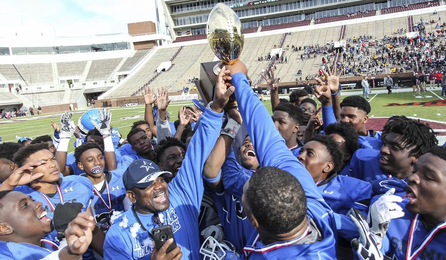 Simmons' players and coaches cerebrate their 30-26 win over Lumberton in the MHSAA Class 1A championship football game at Davis Wade Stadium in Starkville, Miss., Friday, Dec. 2, 2016. (James Pugh/The Laurel Chronicle, via AP)