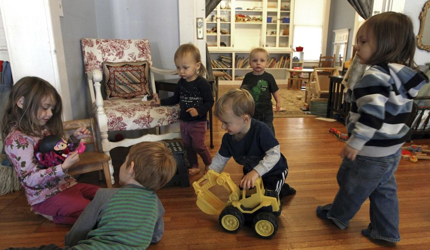 ADVANCE FOR SUNDAY DEC. 4 AND THEREAFTER - In this Monday Nov. 21, 2016 photo, children explore and play together at So Social LLC,  a drop-in, Montessori-inspired child care center in Huntington, W.Va. (Lori Wolfe/The Herald-Dispatch via AP)