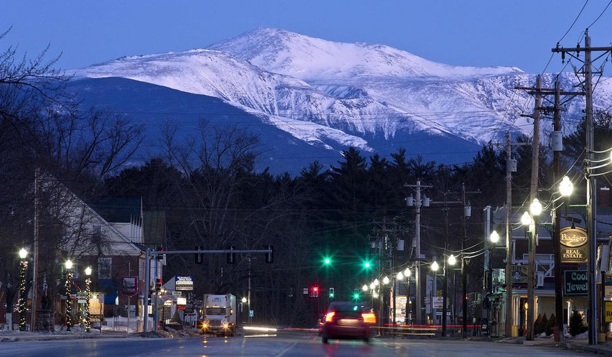FILE  - In this March 13, 2015 file photo, Mount Washington is seen at dawn from North Conway, New Hampshire. The owners of the Mount Washington Cog Railway that climbs to the highest peak in the Northeast want to build an upscale hotel a mile from the summit, in keeping with hotels that once graced the mountain in the 1800s. (AP Photo/Robert F. Bukaty)