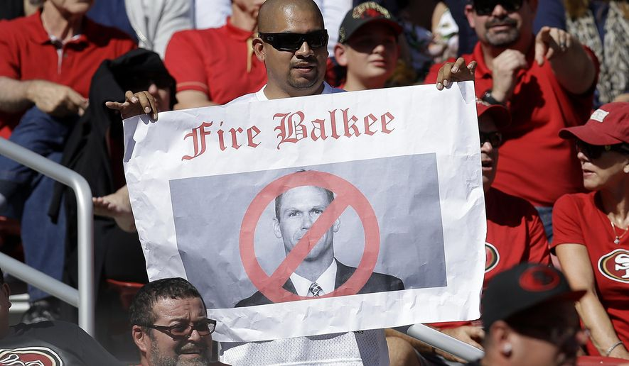 In this Oct. 23, 2016 photo, a fan holds up a sign of San Francisco 49ers general manager Trent Baalke during the first half of an NFL football game against the Tampa Bay Buccaneers in Santa Clara, Calif. The San Francisco 49ers have fallen to a new level of failure and futility, a laughingstock of the league. Among the worst they've ever been when all that winning of just a few years back is still so fresh. After an impressive shutout of the Rams in the season opener that lifted spirits for a turnaround following two straight seasons out of the playoffs, San Francisco has lost a franchise-worst 10 straight games since then. (AP Photo/Ben Margot)