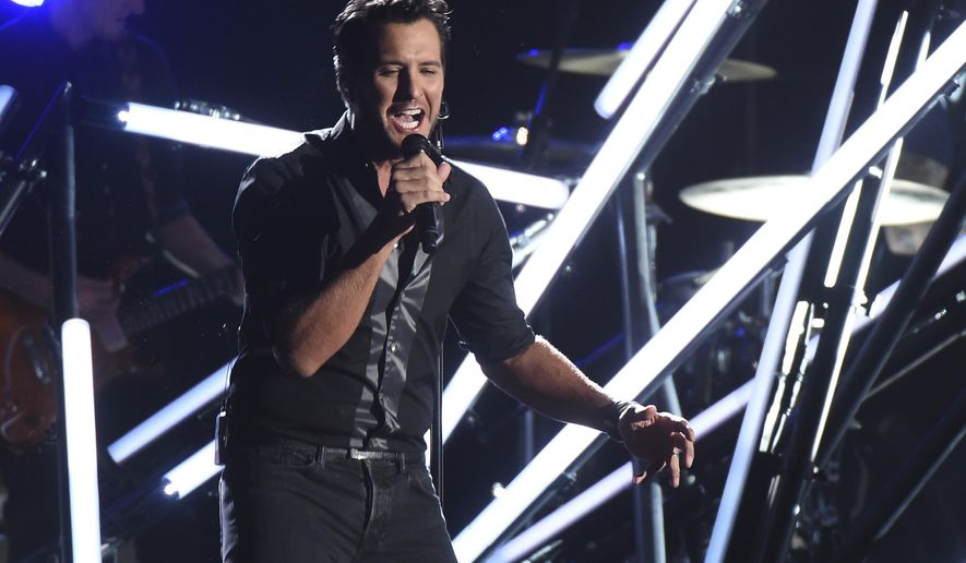 """In this Nov. 2, 2016, file photo, Luke Bryan performs """"Move"""" at the 50th annual CMA Awards at the Bridgestone Arena in Nashville, Tenn. Video shows Bryan slapping a heckler with his fingers while still holding the microphone during a show in Nashville on Nov. 30, 2016. Bryan then continued with the song seeming unfazed by the incident.(Photo by Charles Sykes/Invision/AP, File) **FILE**"""