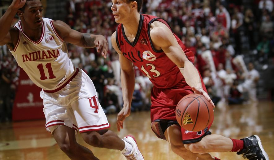 SIU Edwardsville guard Christian Ellis (13) drives in front of Indiana guard Devonte Green (11) in the first half of an NCAA college basketball game in Bloomington, Ind., Friday, Dec. 2, 2016. (AP Photo/AJ Mast)