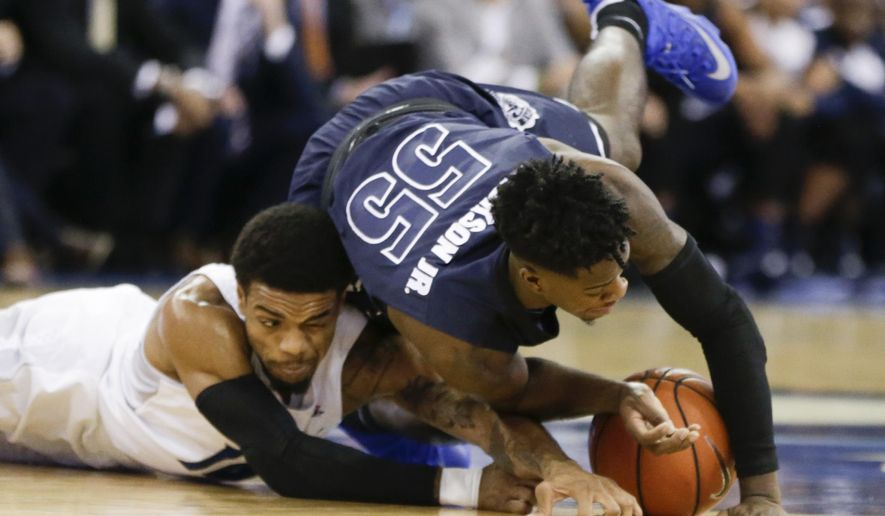 Akron's Antino Jackson (55) leaps for a loose ball against Creighton's Maurice Watson Jr. (10) during the first half of an NCAA college basketball game in Omaha, Neb., Saturday, Dec. 3, 2016. (AP Photo/Nati Harnik)